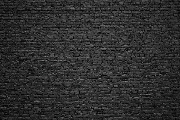 Parede de tijolos pretos, blocos de pedra de textura antiga