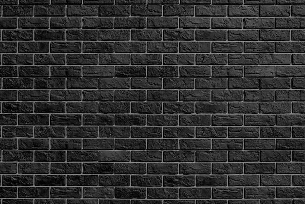 Parede de tijolos pretos. indústria da construção moderna. fachada do edifício.