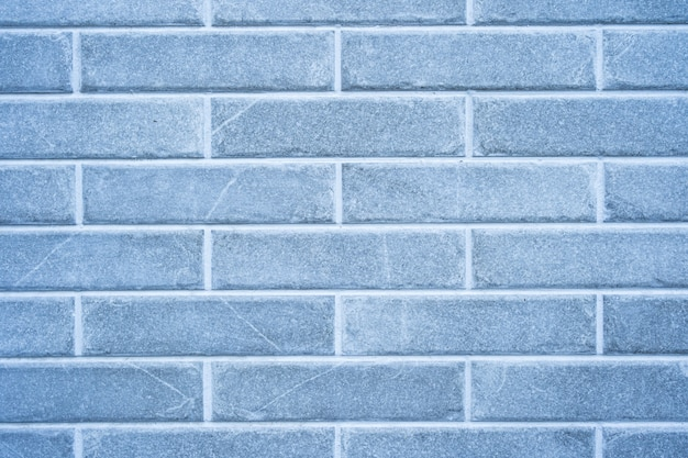 Parede de tijolos. textura de tijolo cinza com recheio branco