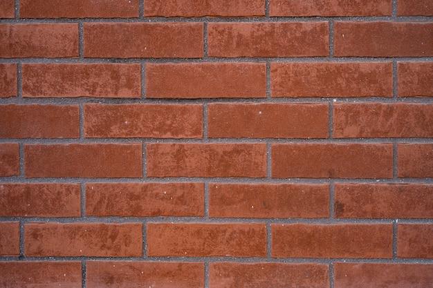 Parede de tijolos. textura de tijolo vermelho com recheio cinza