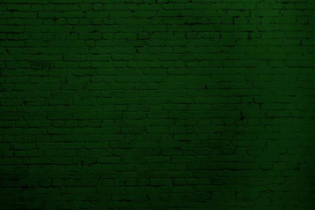 Parede de tijolos verdes. design de interiores do loft. pintura verde de fachada. fundo arquitetônico.