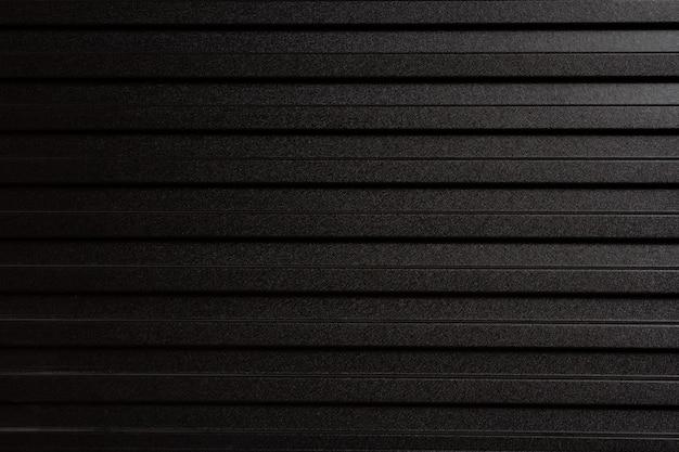 Parede feita de folha de metal cinza. tipo zinco usado como uma cerca para dividir a construção.