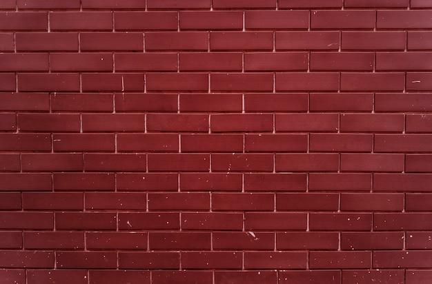 Parede lisa de tijolo vermelho brilhante