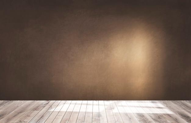 Parede marrom em um quarto vazio com um piso de madeira