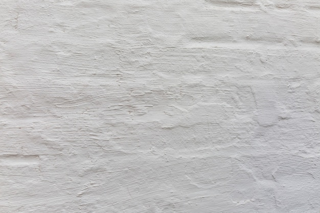 Parede pintada de concreto branco velho. fundo. espaço para texto.