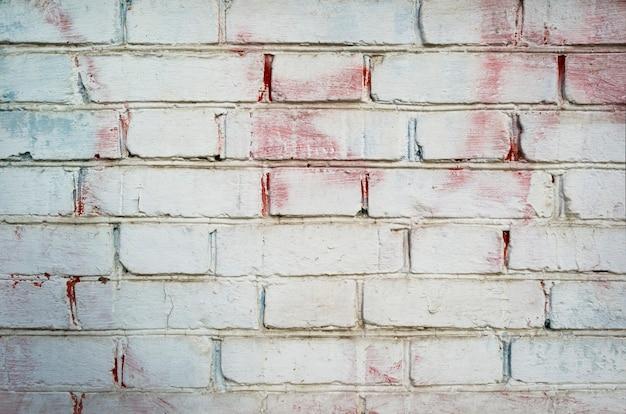 Parede pintada de tijolo branco velho para textura ou plano de fundo