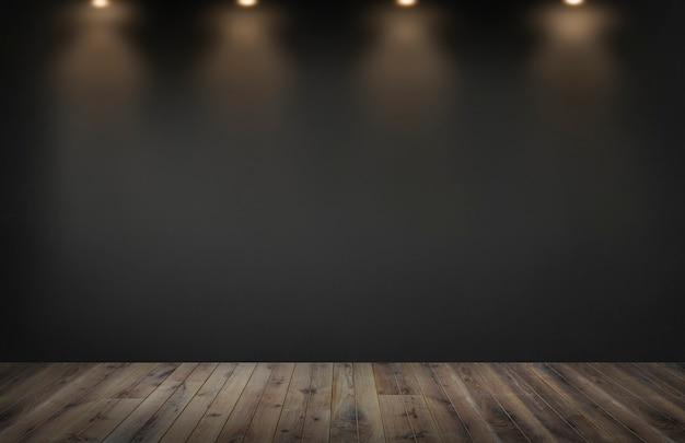 Parede preta com uma linha de holofotes em um quarto vazio
