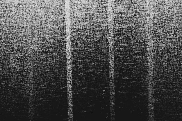 Parede preto e branco da textura do fundo estuque do concreto do pagamento.