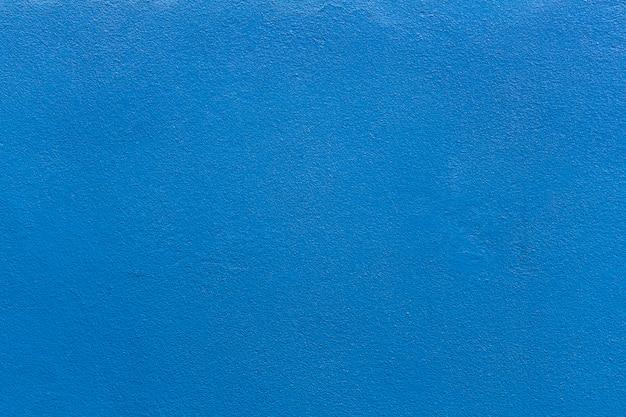 Parede rebocada com textura de tinta azul