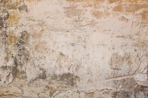Parede suja velha com textura de fundo horizontal abstrato de gesso danificado.