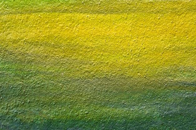 Parede textured verde-amarela da cor.