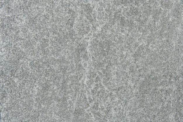 Parede texturizada com padrão de mármore cinza