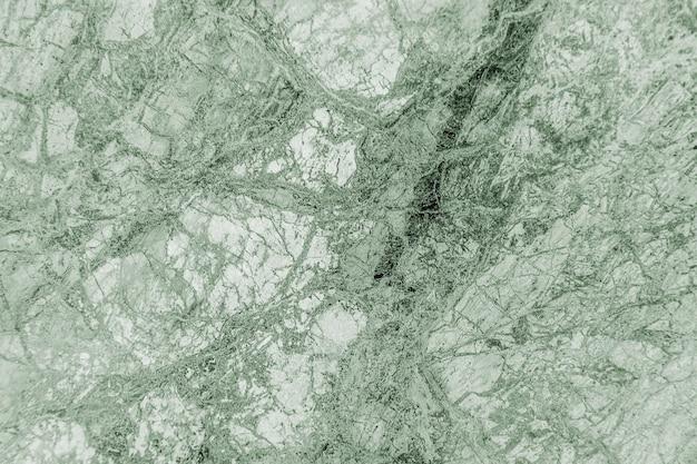Parede texturizada com padrão de mármore verde