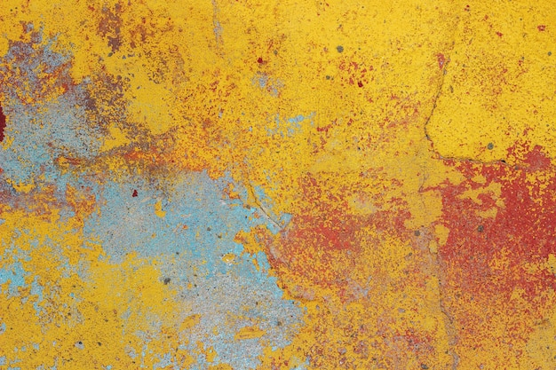 Parede velha com casca de gesso colorido, textura