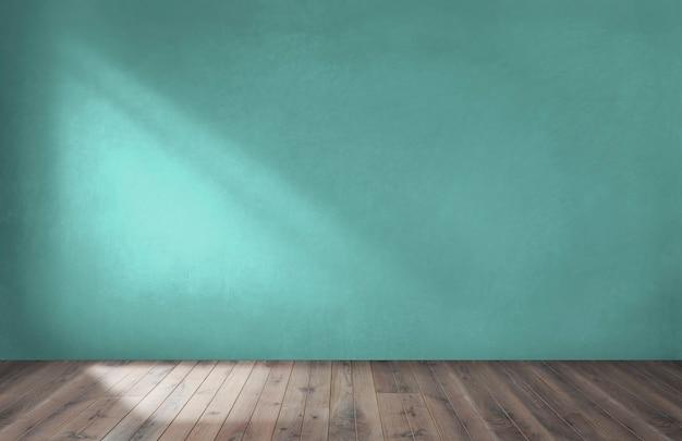 Parede verde em um quarto vazio com um piso de madeira