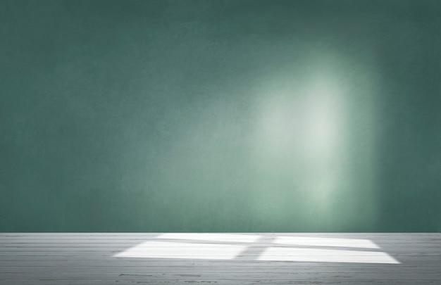 Parede verde em uma sala vazia com piso de concreto