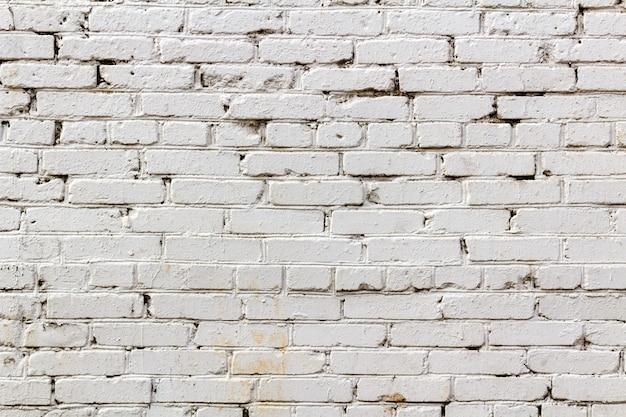 Paredes de tijolo vintage pintadas de branco. fundo abstrato