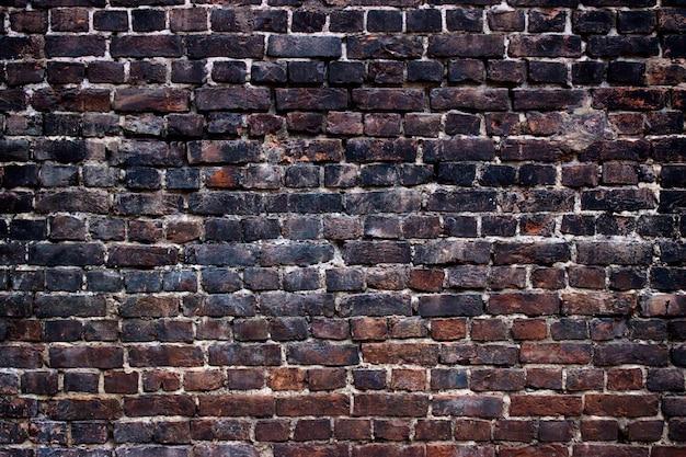 Paredes pretas de fundo, textura de tijolo escuro para design