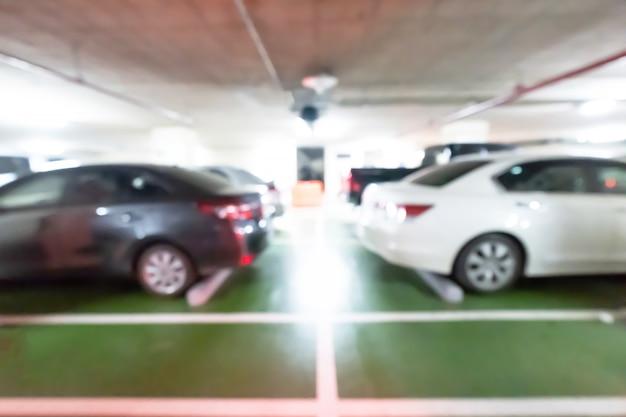 Parque de estacionamento do carro, estacionamento abstrato do carro do borrão no shopping.