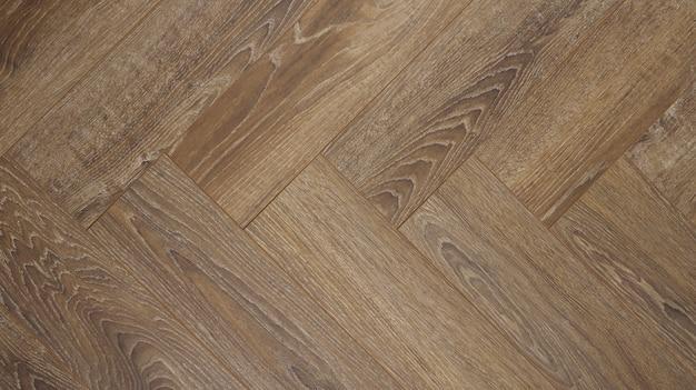 Parquet. assoalho de madeira com textura de madeira e prancha. fundo de madeira