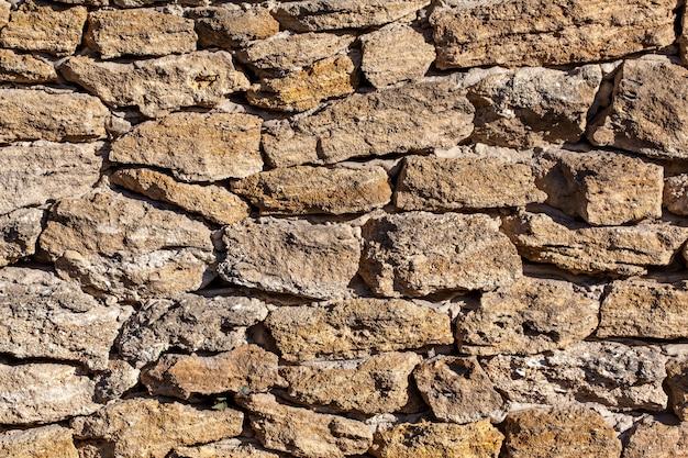 Parte de um muro de pedra medieval, plano de fundo ou textura