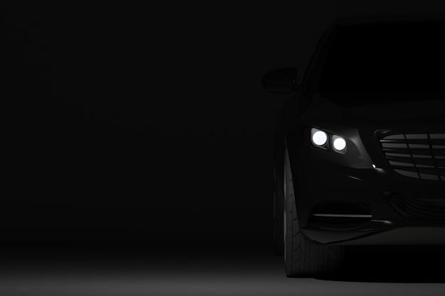 Parte de vista frontal do carro preto moderno closeup em fundo preto, detalhe de faróis