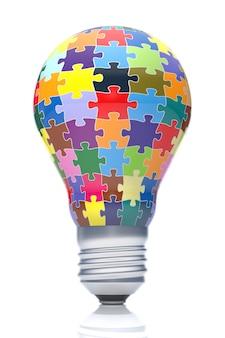Parte dos quebra-cabeças em forma de lâmpada. design criativo com peças coloridas de quebra-cabeça