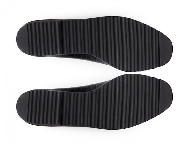 Parte inferior dos sapatos, isolada no branco.