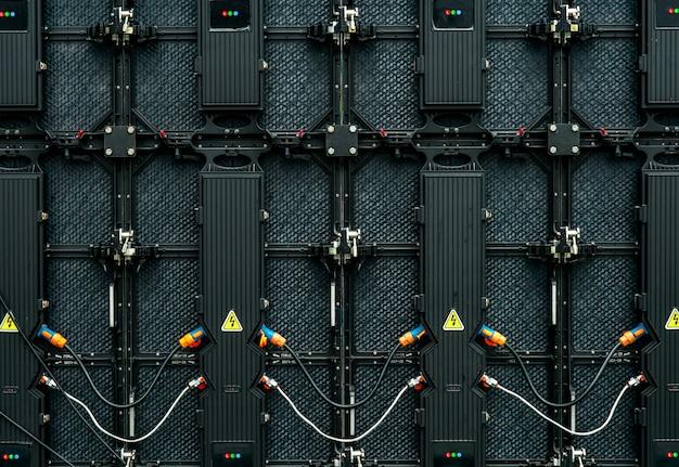 Parte traseira da tela grande do monitor da tela do diodo emissor de luz. textura da vista traseira dos painéis de led.