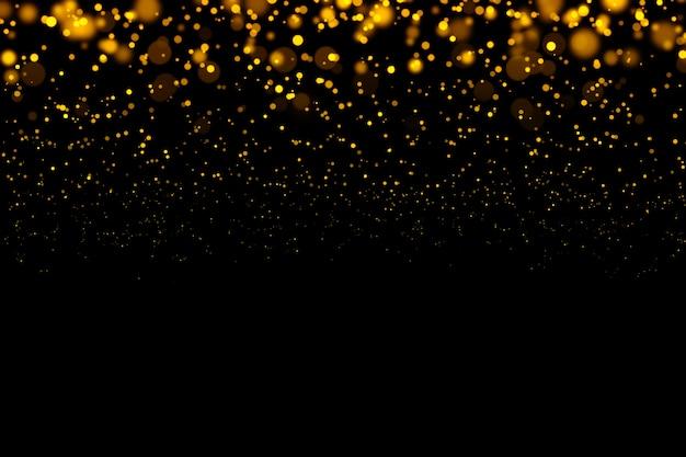 Partículas abstratas de bokeh luz brilhante ouro em fundo escuro.