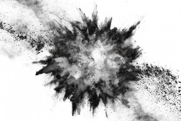 Partículas de carvão em fundo branco.