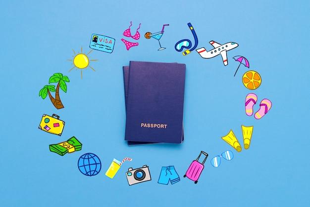 Passaporte e ícones adicionados da viagem e descanso na superfície azul