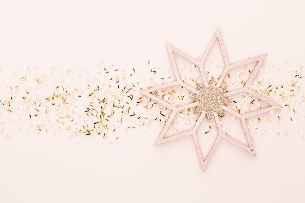 Pastel festivo. estrelas de natal e purpurina brilhante