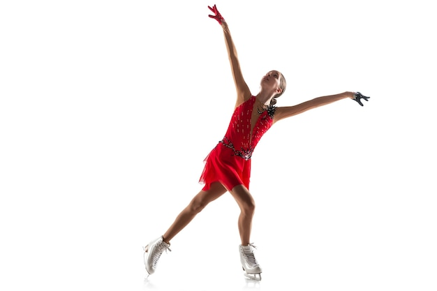 Patinação artística da menina isolada. prática profissional e treinamento em ação e movimento no gelo. gracioso e sem peso. conceito de movimento, esporte, beleza.