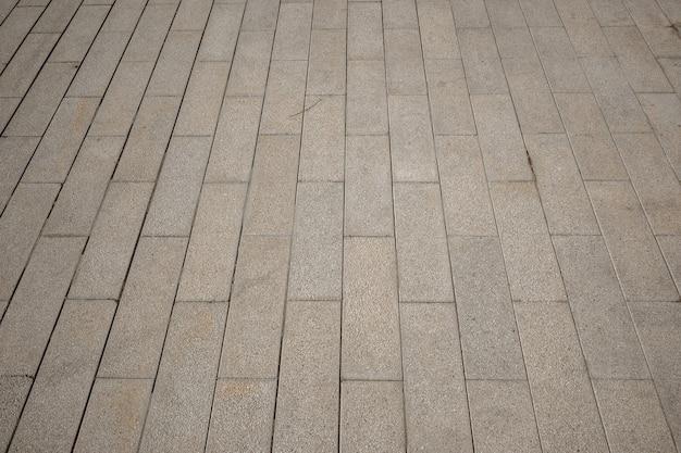 Pavimentação piso de tijolo pavimentação pedra vista em perspectiva monótono ladrilhos de tijolo cinza textura de paralelepípedos de estrada