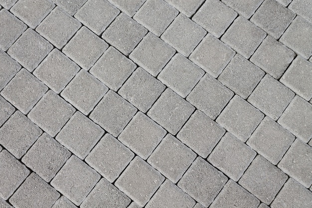 Pavimento de pedra natural em forma de ladrilho. fundo de textura para designers.