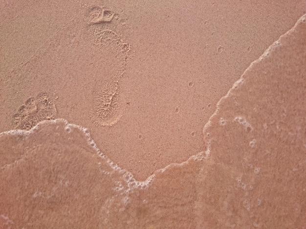 Pé de impressão e fundo de areia