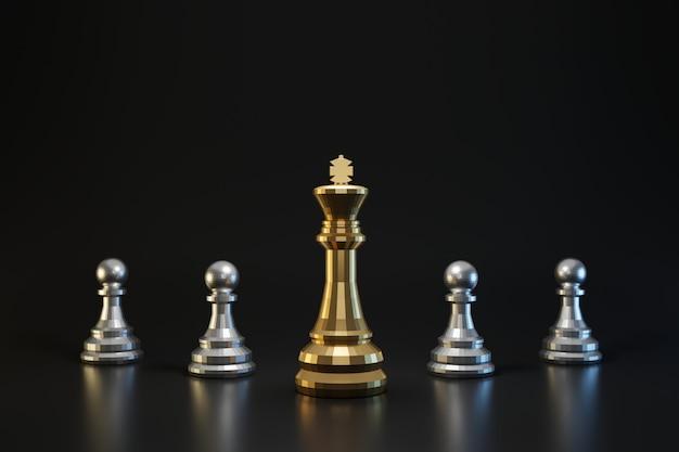 Peça de xadrez dourada e prata na parede escura com estratégia ou conceito de planejamento. rei do xadrez e idéias de negócios. renderização em 3d.