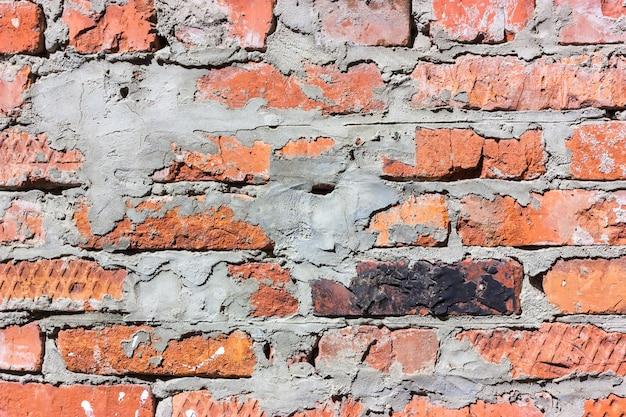 Ped e textura branca da parede de tijolo. fechar-se