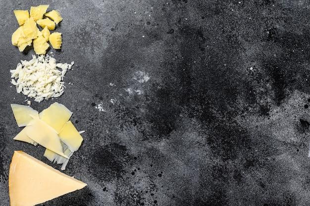 Pedaços de queijo duro parmigiano reggiano