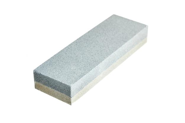 Pedra de amolar retangular de camada dupla. mó isolado em fundo branco