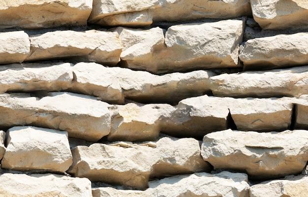 Pedra de fundo de textura perfeita forrada com paredes de arenito de granito