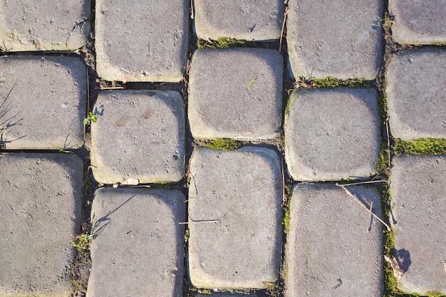Pedra de pavimentação cinza em close do parque