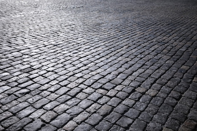Pedra de pavimentação cinza, passarela para pedestres, pavimentação perto, a textura, vista superior. fundo de piso de pedra quadrada de tijolo de cimento. lajes de pavimentação de concreto. lajes para pavimento