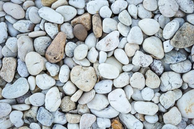 Pedra de seixos brancos ou textura e fundo de pedra de rio