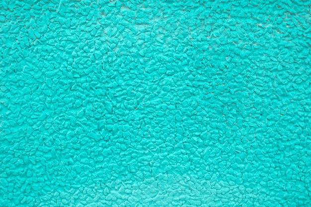 Pedra do cascalho pintado fundo azul textura.