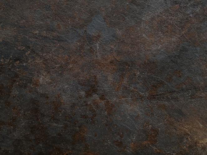 Pedra enferrujada marrom vazia ou textura da superfície de metal