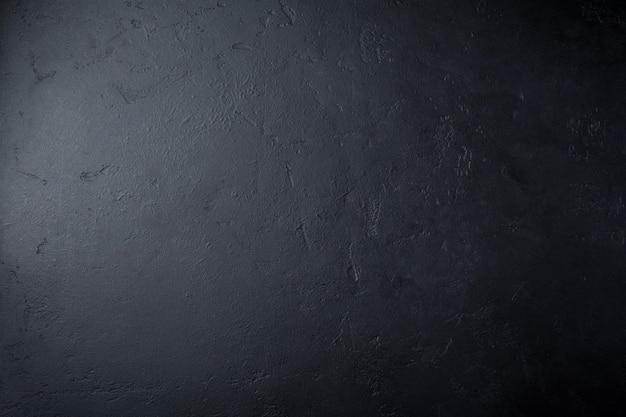 Pedra escura ou parede de ardósia. fundo de textura do grunge.