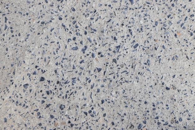 Pedra na textura do close up de concreto e fundo abstrato da queda da estrada do cimento