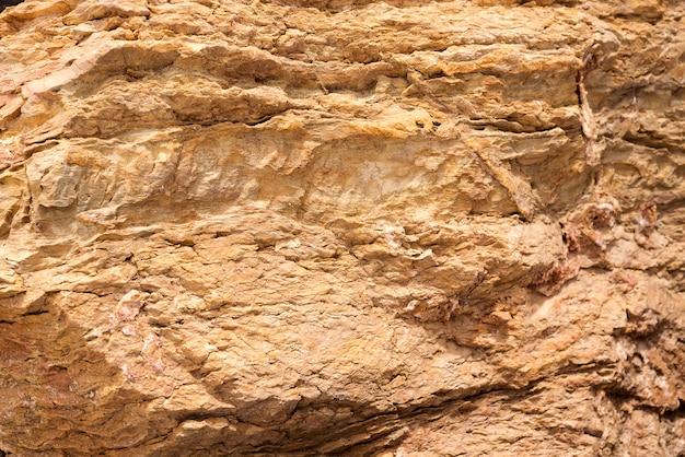 Pedra natural do fundo de pedra da textura do fundo.